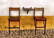 Cobblestone Prints - Weathered Bar Stools of the Medieval Town of Obidos Print by David Letts