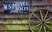 Meyer Framed Prints - Weathered Wood Wagon Wheel Framed Print by David Letts