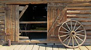 Rusted Barrels Framed Prints - Western Stable Door and Wagon Wheel Framed Print by John Malone