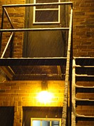 Guy Ricketts Photography Prints - Wet Snow on a Black Metal Balcony Print by Guy Ricketts