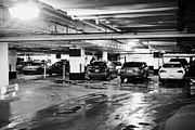 Under Ground Framed Prints - wet underground heated car park during winter in Saskatoon Saskatchewan Canada Framed Print by Joe Fox
