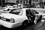Manhatten Framed Prints - white caucasian passenger closes rear door of yellow cab on taxi rank at crosswalk on 7th Avenue Framed Print by Joe Fox