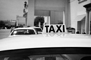 Rank Framed Prints - White Roof Of Taxi Waiting In A Rank Outside A Shopping Mall Florida Usa Framed Print by Joe Fox