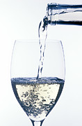 Drinks Photos - White wine pouring by Garry Gay