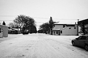 Sask Prints - wide residential street in the small rural town of Kamsack Saskatchewan Canada Print by Joe Fox