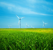 Industry Art - Wind turbines on green field by Michal Bednarek