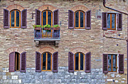 Weathered Shutters Framed Prints - Windows of a Tuscan Office Building Framed Print by David Letts