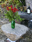 Wine And Red Flowers On The Rocks Print by Les Palenik