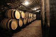 Piled Prints - Wine barrels in a cellar. Cote dOr. Burgundy. France. Europe Print by Bernard Jaubert