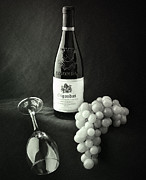 Black And White Photography Photos - Wine Bottle Grapes and Glass by Ian Barber