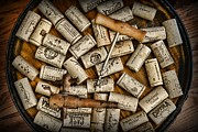Stoppers Framed Prints - Wine Corks on a Wooden Barrel Framed Print by Paul Ward