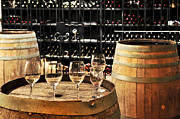 Cellar Photo Prints - Wine glasses and barrels Print by Elena Elisseeva