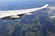 Sami Sarkis - Wing of flying airplane over german villages