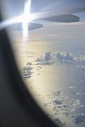 Sami Sarkis - Wings of flying airplane over ocean
