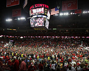 Madison Framed Prints - Wisconsin Fans Rush the Court at the Kohl Center Framed Print by Replay Photos