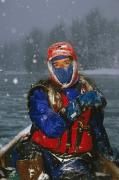 Snowstorm Art - Woman Canoeing In Snowstorm Winter by Michael DeYoung