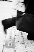 Berlin Germany Photo Prints - woman carrying shopping bag walking over double row of bricks across berlin to mark the position of the berlin wall berliner mauer Berlin Germany Print by Joe Fox