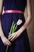 Purple Sash Prints - Woman Holding A Pink Tulip Print by Lee Avison