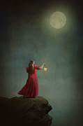 Oil Lamp Photos - Woman In A Red Dress With Lantern On Clifftop by Lee Avison