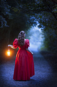 Hurricane Lamp Prints - Woman In A Vintage Red Dress Holding A Lantern Print by Lee Avison