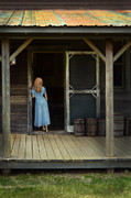 Tin Roof Prints - Woman in Cabin Doorway Print by Jill Battaglia