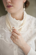 Jewellery Framed Prints - Woman In Period Clothing With Pearl Necklace Framed Print by Lee Avison