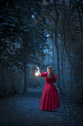Hurricane Lamp Prints - Woman In Red With Lantern Print by Lee Avison
