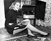 Fidelity Metal Prints - Woman Listening To Records Metal Print by Underwood Archives