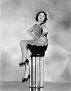 Hands On Hips Posters - Woman On A Pedestal Poster by Underwood Archives