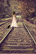 Cat Woman Framed Prints - Woman On Railway Line Framed Print by Christopher and Amanda Elwell