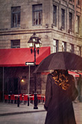 Sandra Cunningham - Woman walking with umbrella on city street in Montreal