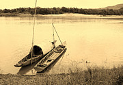 Peaceful Scene Pyrography Prints - wooden boat on Mekong river Print by Thanapol Kuptanisakorn