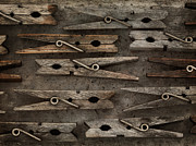 Dry Wood Prints - Wooden Clothespins Print by Priska Wettstein