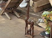 Travel Sculpture Posters - Wooden Giraffe Poster by Hilary Bime
