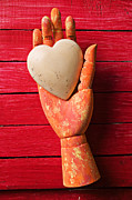Feelings Posters - Wooden hand with white heart Poster by Garry Gay