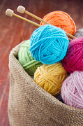 Basket Ball Posters - Woolen balls of yarn in a rustic craft bag Poster by Anna-Mari West