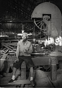 Machine Framed Prints - Workman In An Old Wooden Sawmill Framed Print by Setsiri Silapasuwanchai