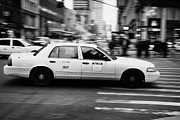 Manhatan Photo Prints - Yellow Cab Blurring Past Crosswalk And Pedestrians New York City Usa Print by Joe Fox
