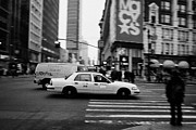 Manhatan Photo Prints - yellow cab taxi blurs past pedestrian waiting at crosswalk on Broadway outside macys new york usa Print by Joe Fox