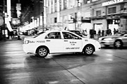 Speeding Taxi Prints - yellow cab taxi crossing junction downtown Vancouver city at night BC Canada deliberate motion blur Print by Joe Fox