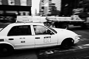 Manhatan Photo Prints - Yellow Cab With Advertising Hoarding Blurring Past Crosswalk And Pedestrians New York City Usa Print by Joe Fox