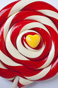 Round Framed Prints - Yellow candy heart on sucker Framed Print by Garry Gay