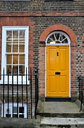 White Frame House Prints - Yellow door and window in brick house Print by Imran Ahmed