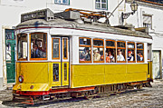 Tram Prints - Yellow Electric Trolly of Lisbon Print by David Letts