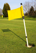 Golf Hole Posters - Yellow Flag on the Green Poster by Semmick Photo