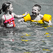 Boy And Girl Prints - Yellow Floaties Print by Christy Usilton
