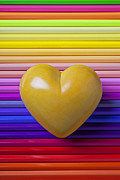 Color Pencils Prints - Yellow heart on row of colored pencils Print by Garry Gay