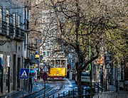 Narrow Streets Prints - Yellow Tram in Lisbon Print by Marion McCristall