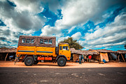 Travel Truck Posters - Yellow truck in Africa Poster by Sabino Parente