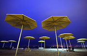 Beach Umbrella Posters - Yellow Umbrellas on Quiet Beach Poster by Charline Xia